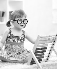 girl with glasses playing the abacus toy
