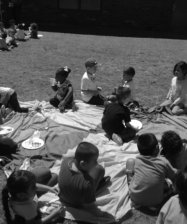 group of children having picnic outside the classroom