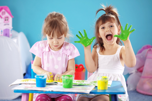 toddlers playing with paint