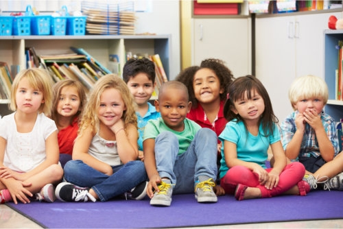 multi-ethnic group of kids in a childcare facility